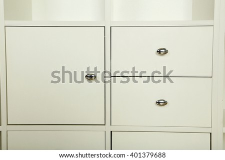 White wooden boxes, white chest of drawers
