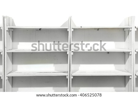 White wooden empty shelves on the store wall - stock photo