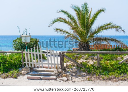 white wooden gate in a tropical resort - stock photo