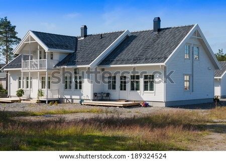 white wooden house in norway - stock photo