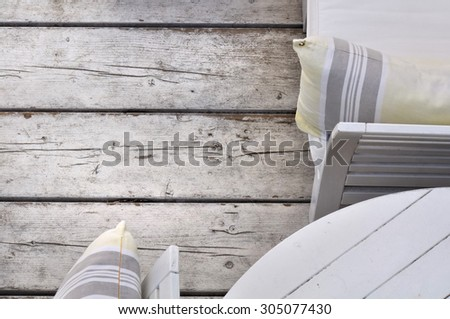 white wooden lounge terrace on wooden floor - stock photo
