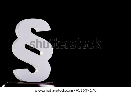 White wooden paragraph - law symbol on black background. Law concept - stock photo