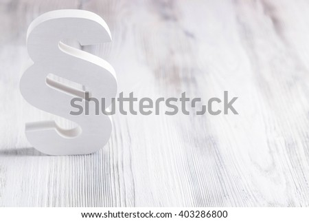 White wooden paragraph the symbol of law on old wooden floor. Law concept - stock photo