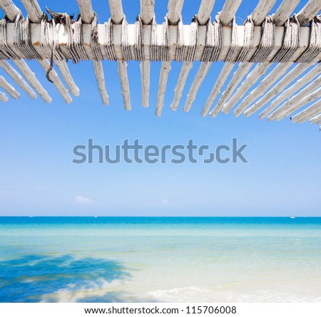White wooden roof of a hut by the beach in Hua Hin, Thailand - stock photo