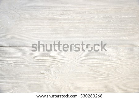 White wooden surface. Textured board painted with white paint. Natural pattern