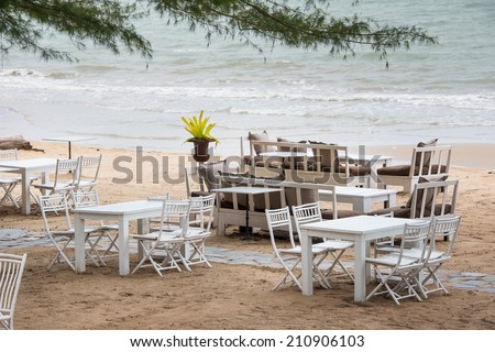 White wooden table set on sand beach