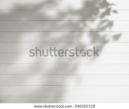 white wooden wall texture. light and shadow. - stock photo