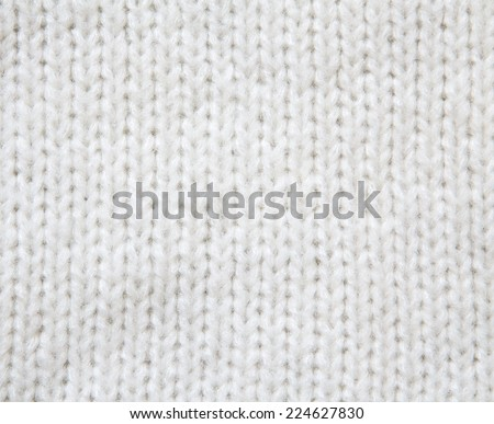 White woolen crocheted knitted sweater background. Close up - stock photo