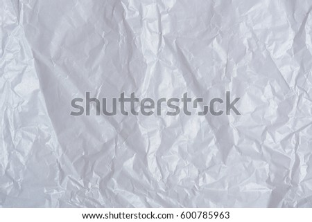 White wrinkled paper background. Blank crumpled paper surface