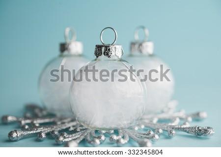 White xmas ornaments on light blue background. Merry christmas card. Winter holidays. Xmas theme. - stock photo