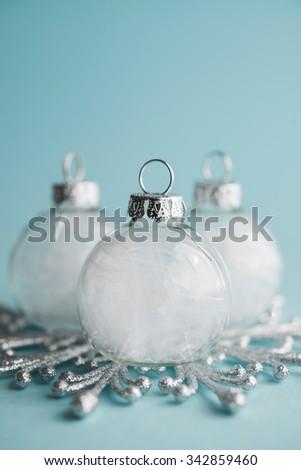 White xmas ornaments on light blue background. Merry christmas card. Winter holidays. Xmas theme.Happy New Year. - stock photo