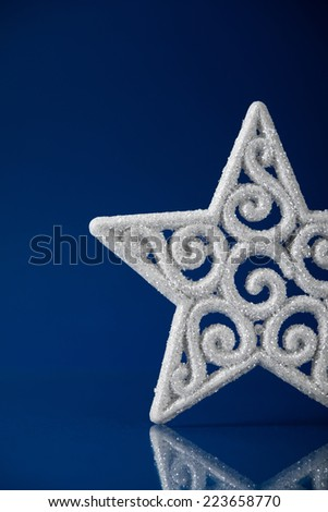 White xmas star on dark blue christmas background with space for text. - stock photo