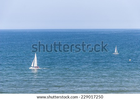 White Yacht at sea at summer time - stock photo