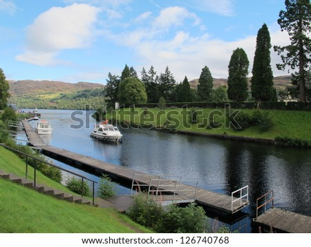 White yacht in a small lake, Lochness, Scotland - stock photo