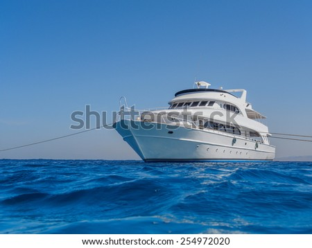 White yacht in the blue tropical sea, diving safari boat for  liveaboard - stock photo