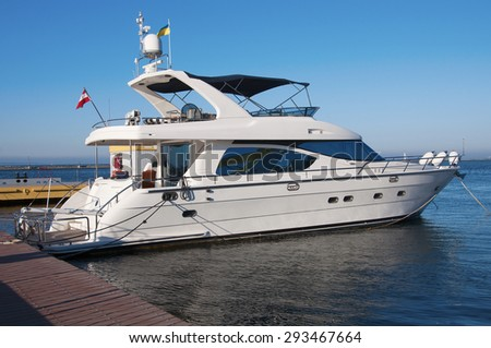 White yacht in the port. On the sea calm. - stock photo