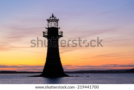 Whiteford Point Lighthouse silhouetted at  sunset.