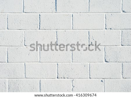 Whitewashed breezeblock wall close up.