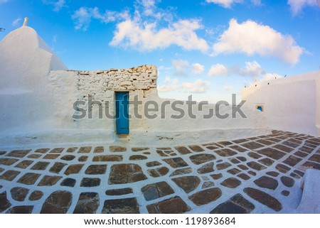 Whitewashed street in Mykonos island cyclades Greece - stock photo