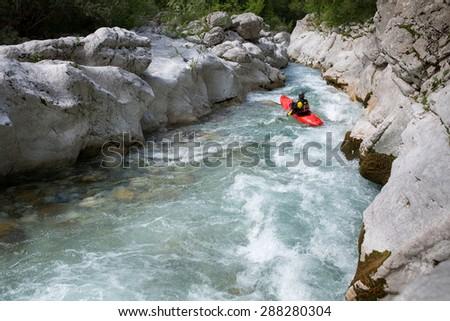 Whitewater kayaking down the rapids - stock photo