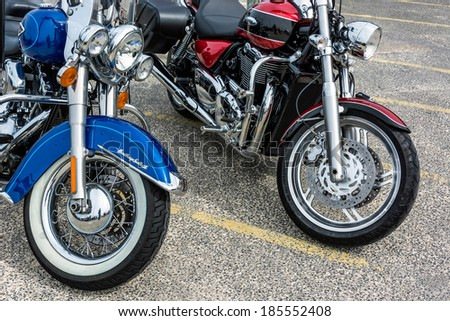 WHITSTABLE, KENT/UK - SEPTEMBER 1 : Close-up of two motorcycles parked in Whitstable on September 1, 2013