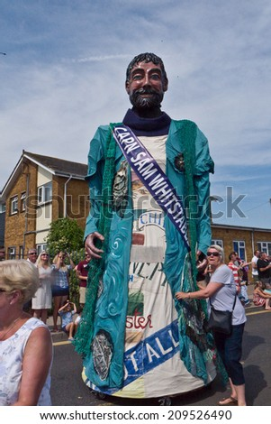 WHITSTABLE,UK-JULY 26: One of the Giants of Kent, Captain Sam  from Whitstable taking part in the annual Whitstable Oyster Festival Parade. July 26 2014. Whitstable UK - stock photo