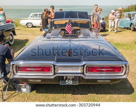 Whitstable, UK, 2nd August 2015. A blue Thunderbird vintage car is on display for visitors to Tankerton slopes to enjoy during the classic car motor show in Whitstable, Kent. - stock photo
