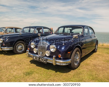 Whitstable, UK, 2nd August 2015. A blue vintage Jaguar car is on display for visitors to Tankerton slopes to enjoy during the classic car motor show in Whitstable, Kent.