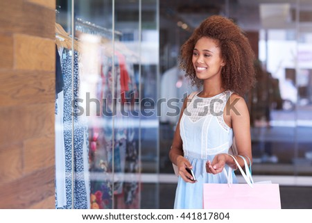 Who doesn't love a bit of window shopping - stock photo