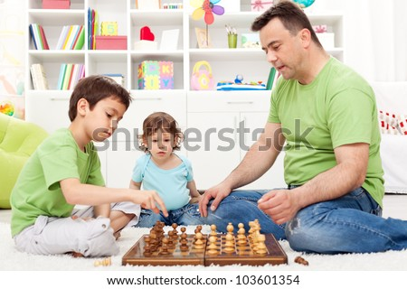 Whoa - that is awesome, toddler boy looking in awe - focus on background child - stock photo