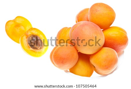 Whole and cut apricots isolated on white - stock photo