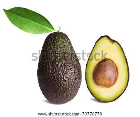 whole and half avocados with leaf isolated on white background - stock photo