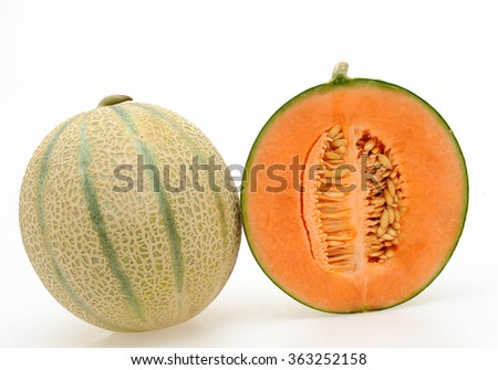 whole and half Cantaloupe melon on a white background - stock photo