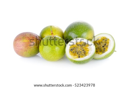 whole and half cut passion fruit on white background