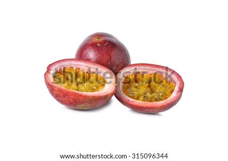 whole and half cut passion fruits on white background - stock photo