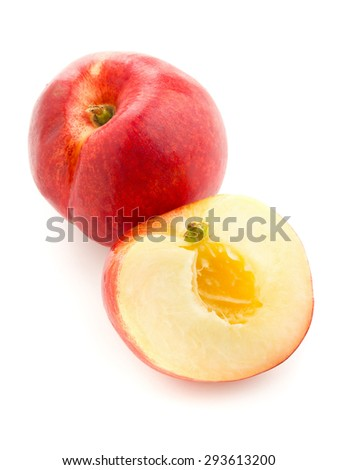 Whole and half cut white nectarine on white background - stock photo