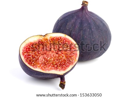 Whole and half fig isolated on white background - stock photo