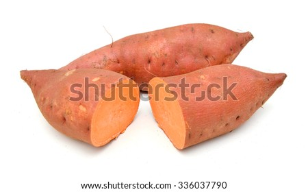 whole and halved sweet potatoes isolated on white