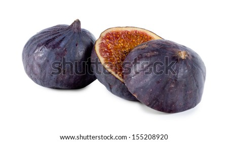 Whole and sliced fresh purple fig showing the texture of succulent sweet pips, healthy snack and cooking ingredient - stock photo