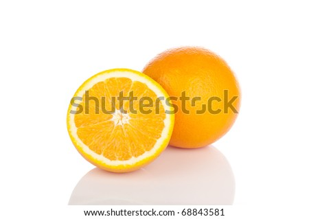 Whole and sliced oranges on a white background.