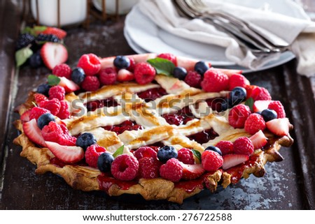 Whole assorted berry lattice pie with raspberry and cherry - stock photo