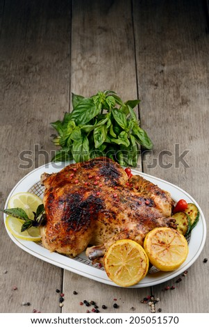 Whole baked chicken with vegetables