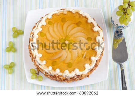 Whole cake decorated with fresh fruits with special spoon - stock photo