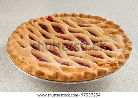 whole cherry pie on a kitchen counter ready to serve