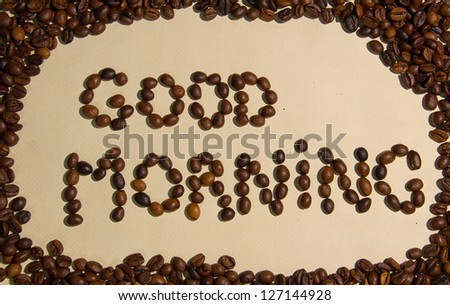"Whole coffee beans spell out ""Good morning!"" - stock photo"