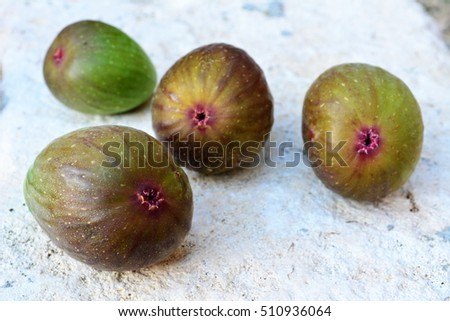 Whole figs on a white stone with a natural DOF