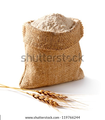 Whole flour in bag with wheat ears - stock photo