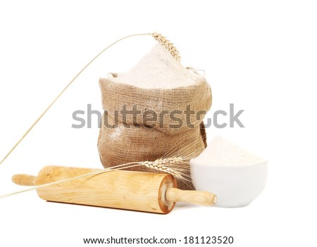 Whole flour in bag with wheat ears. Isolated on a white background. - stock photo