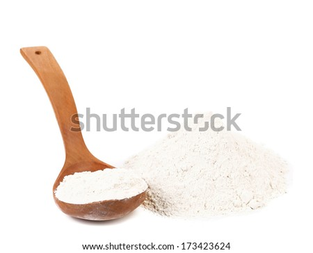 Whole flour in spoon and bunch. Isolated on a white background. - stock photo