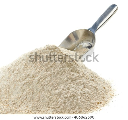 Whole flour pile with scoop on white background - stock photo